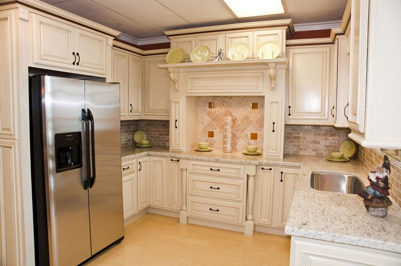Antique white kitchen cabinet pictures for Pictures of white glazed kitchen cabinets